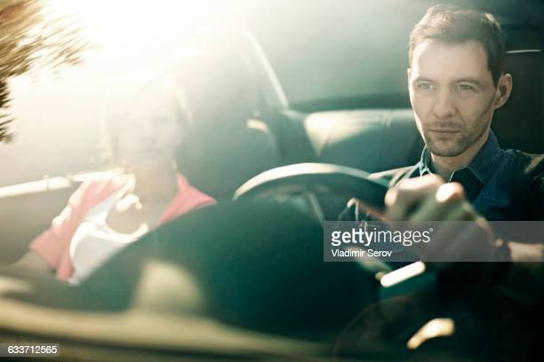 Caucasian father and daughter driving in car