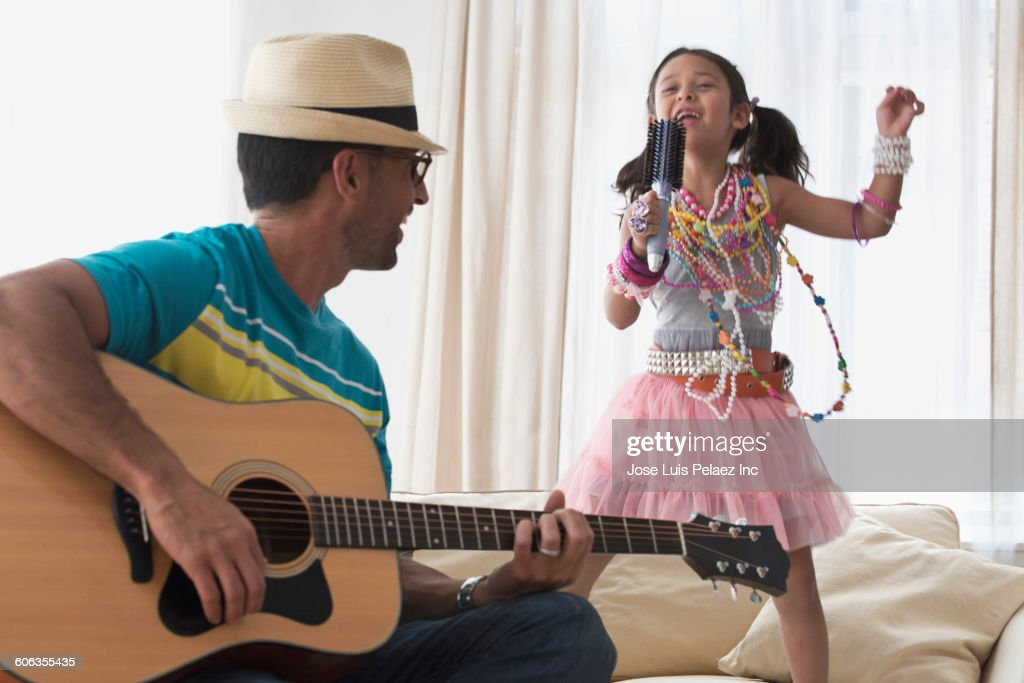 Caucasian father and daughter playing dress-up : Stock Photo