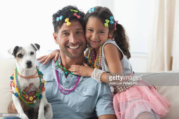 caucasian father and daughter playing dress-up with dog - hair bow stock pictures, royalty-free photos & images