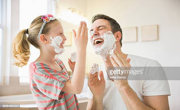 caucasian father and daughter playing with shaving cream - human body part stock-fotos und bilder