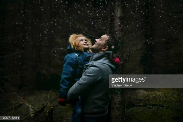 Caucasian father and daughter under starry sky