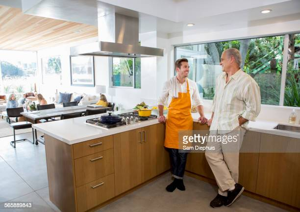 Caucasian father and son cooking in kitchen