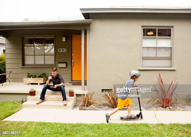 Caucasian father and son relaxing outdoors