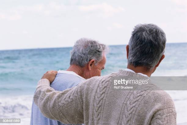 Caucasian father and son walking on beach