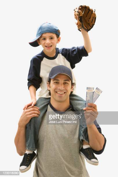 Caucasian father and son with tickets to baseball game