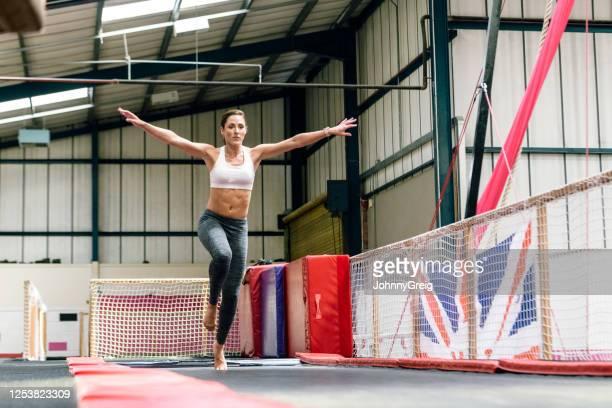 caucasian female athlete preparing to do gymnastics move - floor gymnastics stock pictures, royalty-free photos & images