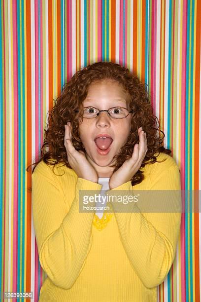 Caucasian female child looking surprised.