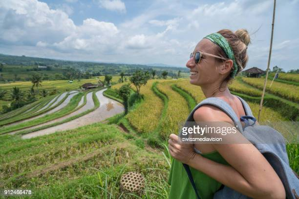 Caucasian female on top of rice terraces in Bali, Indonesia