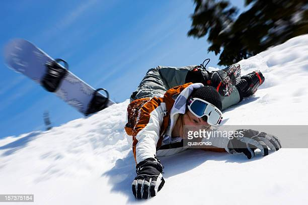 caucasian female snowboarder wipe out on snowy mountain, copy space - winter sport stock pictures, royalty-free photos & images