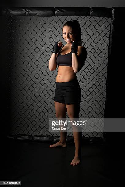 Caucasian fighter standing in gym