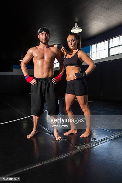 Caucasian fighters standing in gym