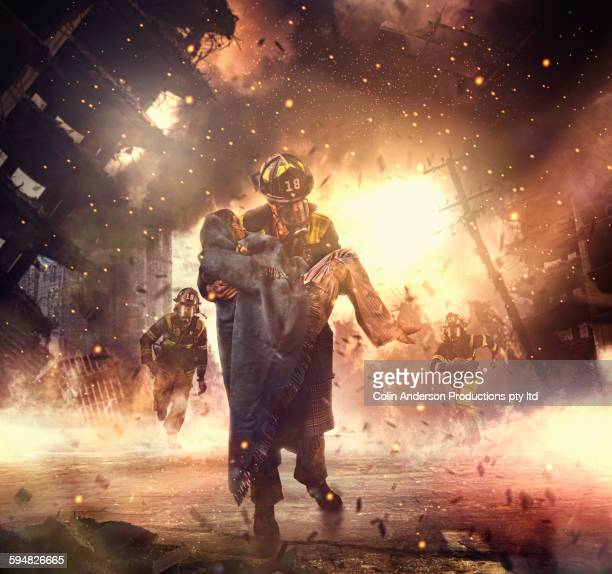 caucasian firefighter saving boy in burning building - rescue worker stock pictures, royalty-free photos & images