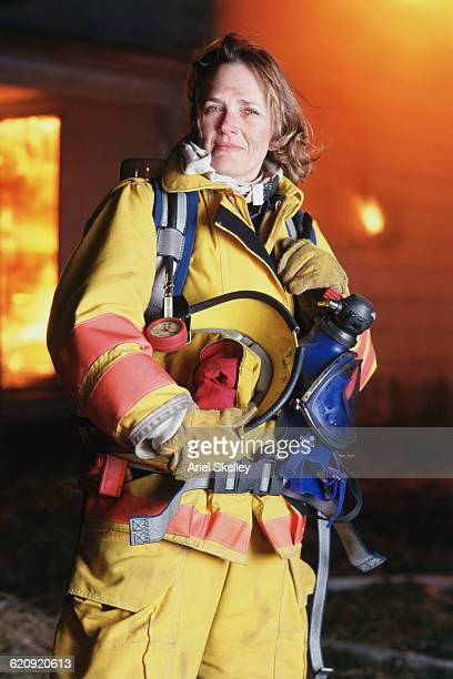caucasian firefighter wearing uniform at fire - hero and not superhero stock pictures, royalty-free photos & images
