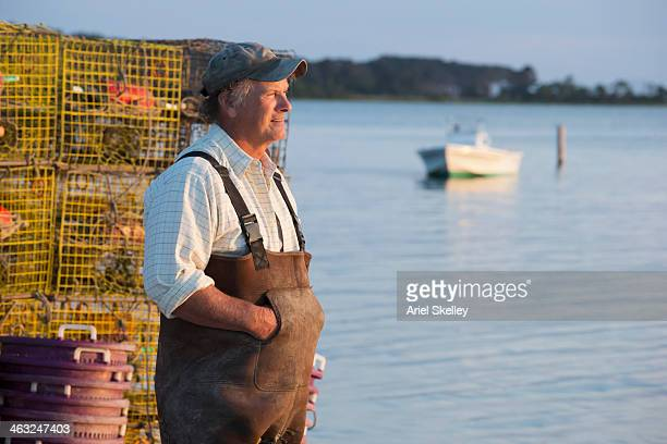 Caucasian fisherman overlooking bay