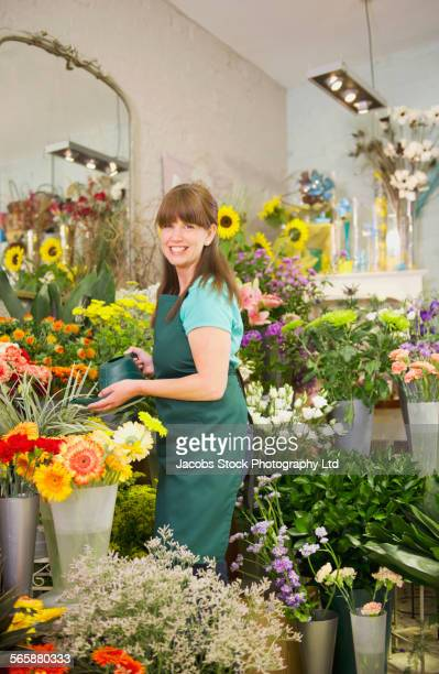caucasian florist working in flower shop - spalding england stock photos and pictures