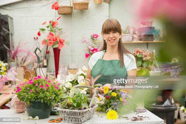 Caucasian florist working in flower shop