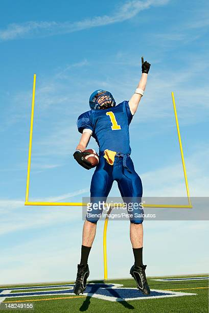 Caucasian football player cheering for victory
