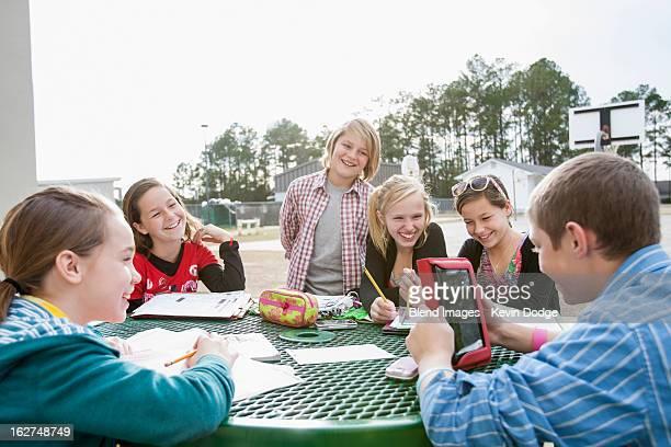 Caucasian friends doing homework together