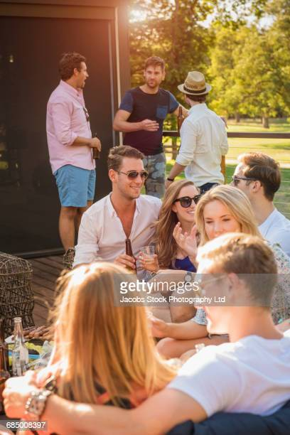Caucasian friends enjoying party on patio