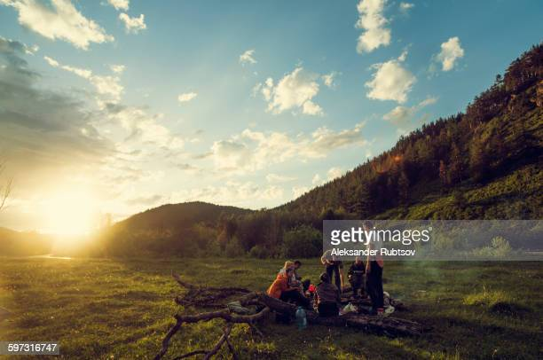 caucasian friends in rural field - campfire stock pictures, royalty-free photos & images