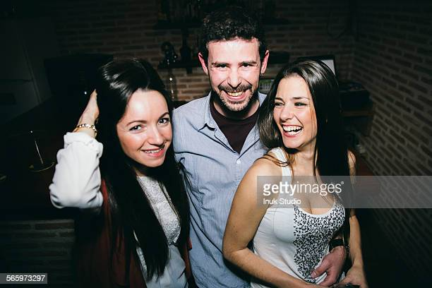 Caucasian friends laughing in nightclub