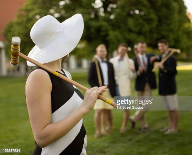 Caucasian friends playing croquet together