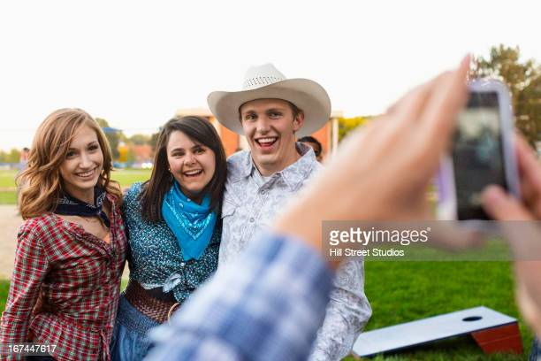 caucasian friends taking pictures together - caldwell idaho foto e immagini stock