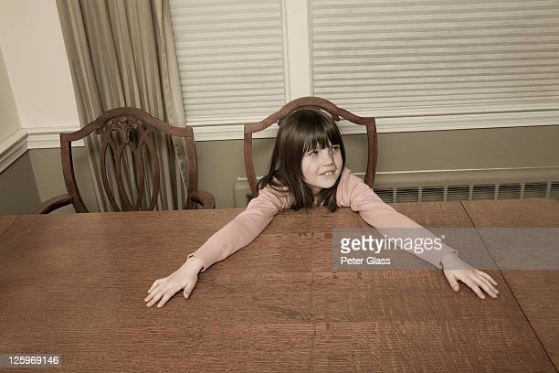 caucasian girl, 8 years old, sitting at the dining room table - 8 9 years stock pictures, royalty-free photos & images