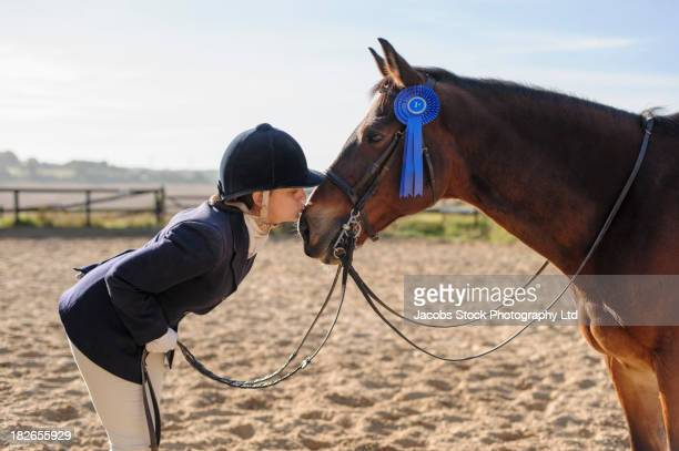 caucasian girl and horse winning equestrian competition - dressage stock pictures, royalty-free photos & images