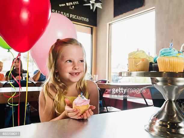 Caucasian girl celebrating birthday in cafe