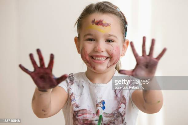 Caucasian girl displaying messy hands