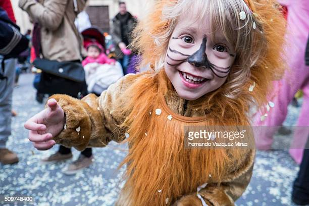 caucasian girl dress up as lion looking at the camera.. - catalonia stock pictures, royalty-free photos & images