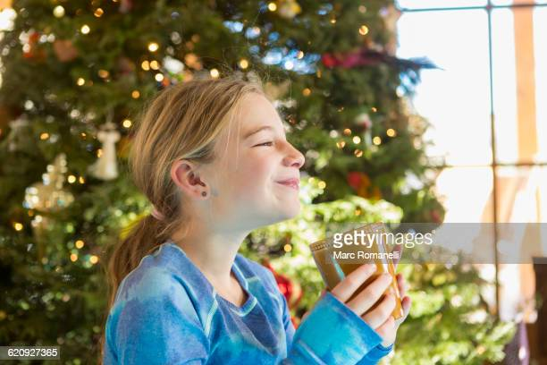 Caucasian girl drinking hot cocoa at Christmas