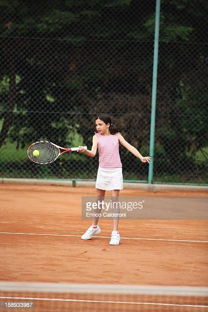 Caucasian Girl Hitting Forehand Shot