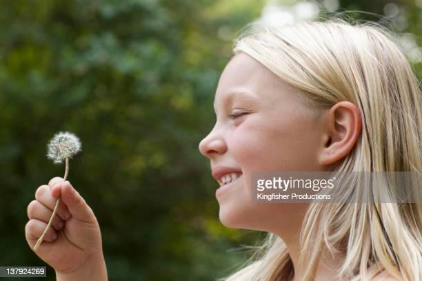 Caucasian girl holding flower