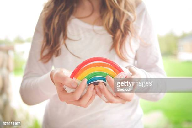 Caucasian girl holding rainbow candy