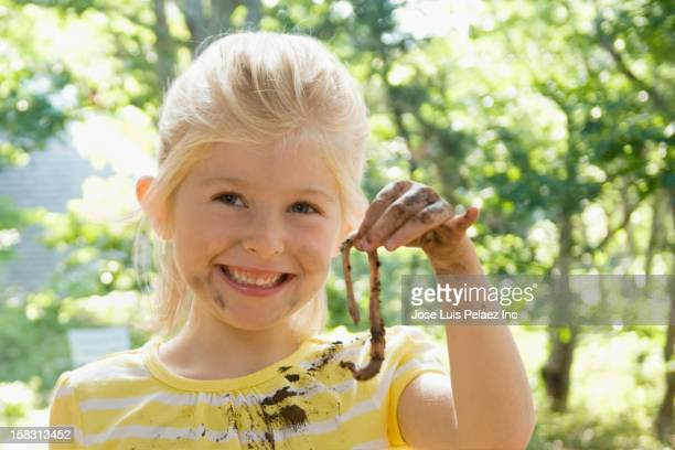 caucasian girl holding worm - worm stock photos and pictures