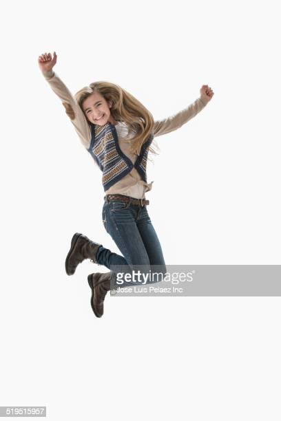 Caucasian girl jumping for joy