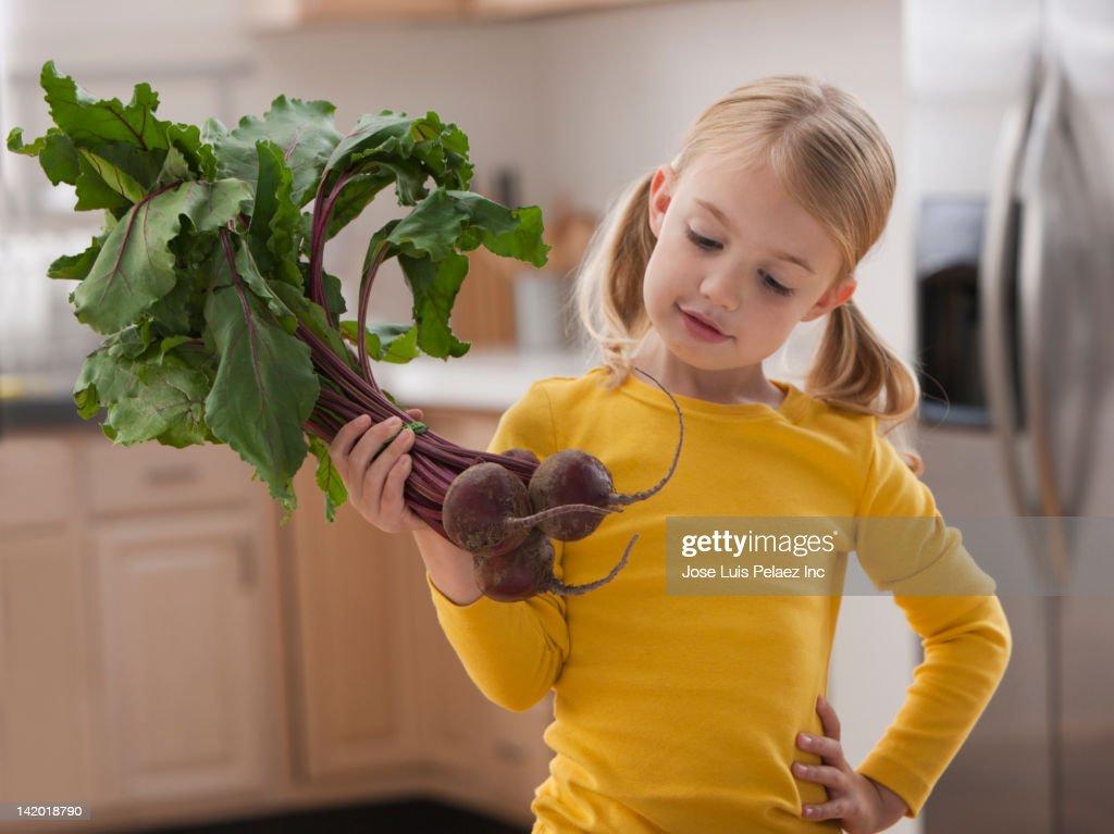 Caucasian girl looking at beets : Stock Photo
