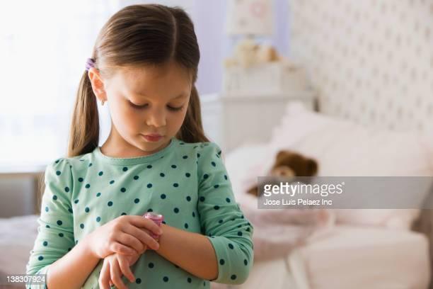 Caucasian girl looking at wristwatch