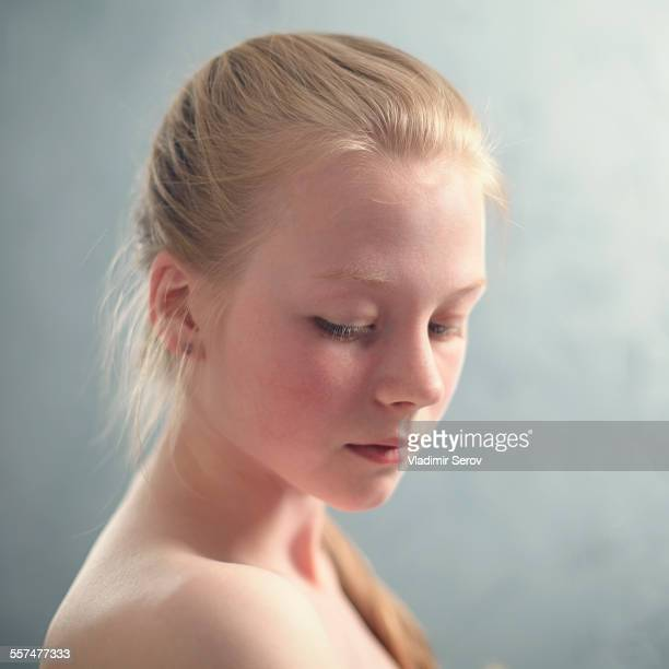 Caucasian girl looking down