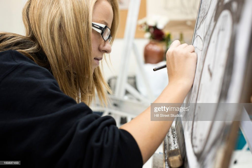 Caucasian girl painting : Stock Photo