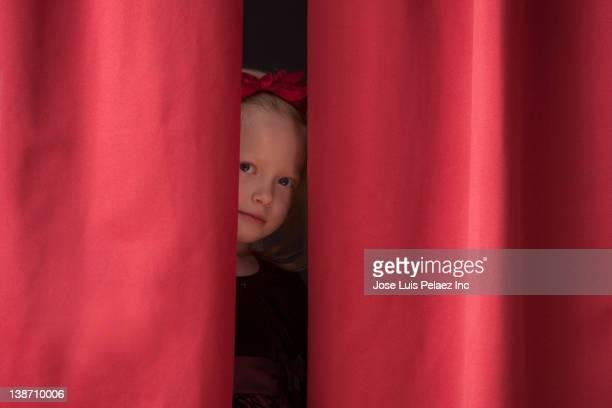 caucasian girl peering from backstage - dietro le quinte palcoscenico foto e immagini stock