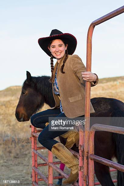 Caucasian girl petting horse on farm