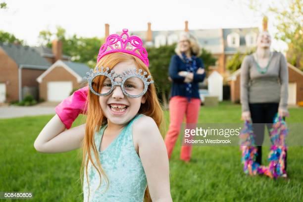 caucasian girl playing dress up in park - tiara stock-fotos und bilder