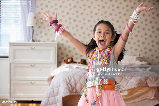 caucasian girl playing dress-up in bedroom - necklace stock pictures, royalty-free photos & images