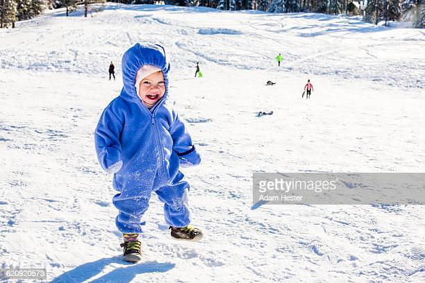 Caucasian girl playing in snow