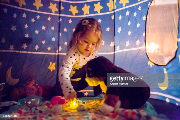 Caucasian girl playing in tent
