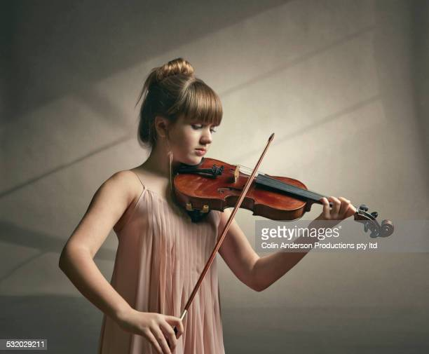 caucasian girl playing violin - fabolous musician stock photos and pictures