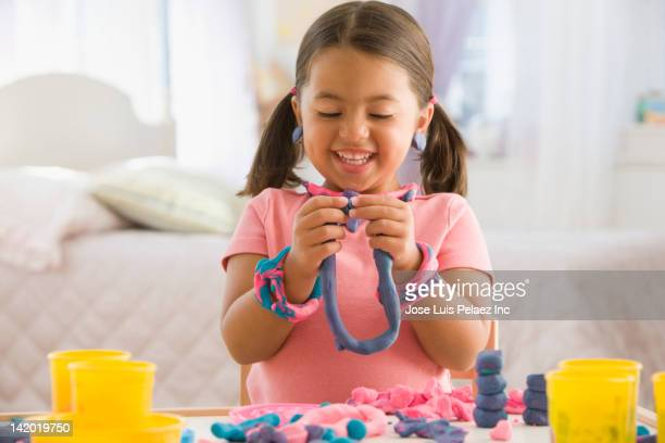 caucasian girl playing with clay - clay stock pictures, royalty-free photos & images